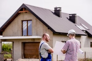 Building surveyors surveying a house